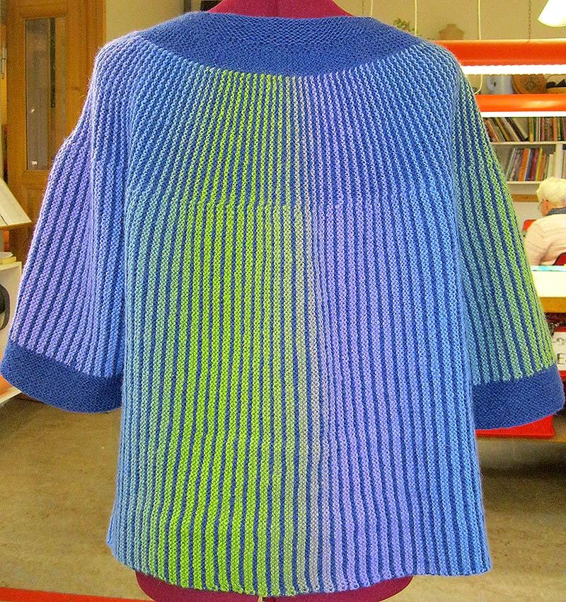 blå vendestrik cardigan bag